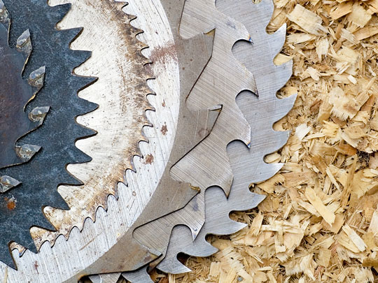 used circular saw blades in sawdust